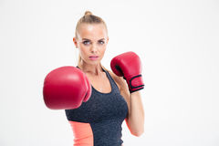 Woman hitting at camera in boxing gloves Royalty Free Stock Photography