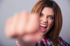 Woman hitting with fist on camera and shouting Stock Photos