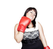 Woman hitting herself with boxing gloves Royalty Free Stock Image