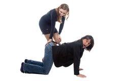 Woman hitting man in black jacket Stock Photos