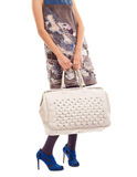 Woman hoding big  purse Stock Photography