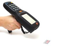 Woman hold bar code scanner and scans  with laser Stock Photo