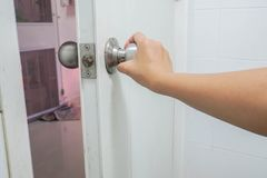 Woman hold bathroom doorknob for exit royalty free stock photos