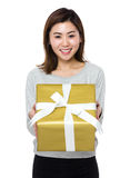 Woman hold with big gift Royalty Free Stock Photo