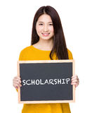 Woman hold blackboard showing a word scholarship Stock Images