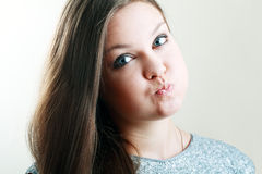 Woman hold breath. Beautiful woman hold breath and puffs up her cheeks Stock Photo
