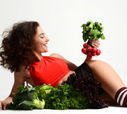 Woman hold bunch of radish lettuce broccoli happy smiling Stock Image
