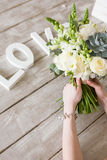 Woman hold bunch with white roses and succulent Stock Images