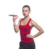 Woman hold chili pepper like smoker Royalty Free Stock Image