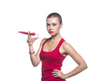Woman hold chili pepper like smoker Royalty Free Stock Photos