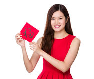 Woman hold with china fai chun, word meaning is good luck Royalty Free Stock Photos