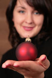 Woman hold christmas ball Stock Photo