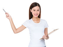 Woman hold with clipboard and pen point up Royalty Free Stock Photography