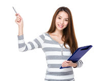 Woman hold with clipboard and pen point up Stock Images