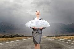 Woman hold cloud . Mixed media royalty free stock photo