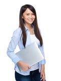 Woman hold computer Stock Photos