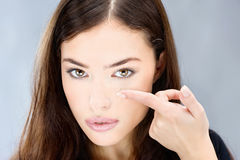 Woman hold contact lens on finger Royalty Free Stock Photography