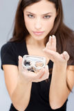 Woman hold contact lenses cases and lens Royalty Free Stock Photography