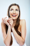 Woman hold cosmetic cream. Beautiful face young model. Stock Image