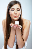 Woman hold cosmetic cream. Beautiful face young model. royalty free stock photos