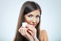 Woman hold cosmetic cream. Beautiful face young model. Stock Photos