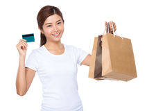 Woman hold credit card and shopping bag Stock Photos
