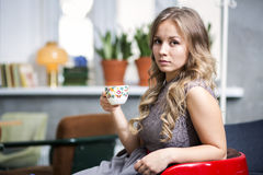 Woman hold cup and look directly Royalty Free Stock Images