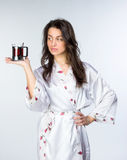 Woman hold cup of tea  in peignoir early morning Stock Photos