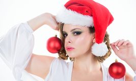 Woman hold decorative balls on white background. Prepare for christmas. Makeup idea for corporate party. Girl with. Makeup and hairstyle ready to celebrate royalty free stock photo