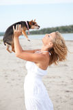 Woman hold dog on beach Royalty Free Stock Photos