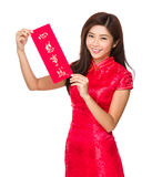 Woman hold with Fai Chun, phrase meaning is dreams come ture Royalty Free Stock Image