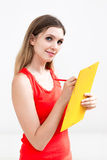 Woman hold a folder of papers and write Stock Image