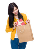 Woman hold gift box from shopping bag Stock Photo