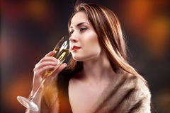woman hold glass of Champagne Stock Images