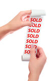 Woman Hold in Her Hands Roll of Paper With Printed Receipt. SOLD text Royalty Free Stock Image