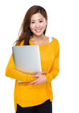 Woman hold laptop computer Stock Images