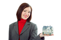 Woman hold little house on hand Stock Images