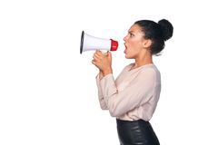 Woman hold loudspeaker. Business, communication, information concept. Side view of angry serious mixed race caucasian - african american business woman screaming Royalty Free Stock Photo