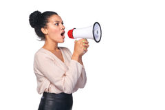 Woman hold loudspeaker. Business, communication, information concept. Side view of angry serious mixed race caucasian - african american business woman screaming Stock Photography