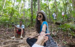 Woman Hold Man Hand, Couple With Backpacks Trekking On Forest Path, Tourists On Hike. Adventure Activity Stock Photography