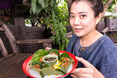 Woman hold Miang Kum Royalty Free Stock Image