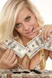 Woman hold money finger lip. A woman with money in her hands counting how much she has Royalty Free Stock Image