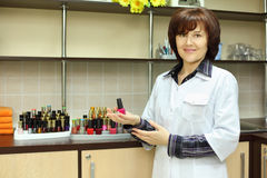 Woman hold nail polish in beauty salon Royalty Free Stock Photo