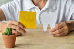 Woman hold paper cuts tooth shape, dental concept Stock Images