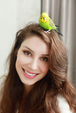 Woman hold parrot Royalty Free Stock Images