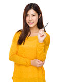 Woman hold with a pen Royalty Free Stock Photography