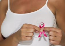 Woman hold pink ribbon for breast cancer awareness stock photography