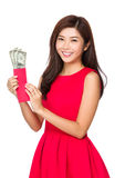 Woman hold pocket money with USD Stock Photo