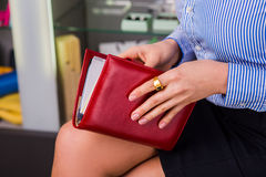Woman hold the red book(diary). Closeup  hands Royalty Free Stock Photos