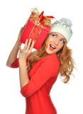 Woman hold red Christmas wrapped gift present smiling stock images